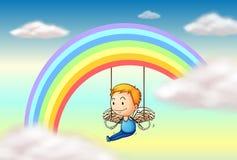 Um anjo perto do arco-íris Foto de Stock Royalty Free