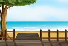 Um banco de madeira em uma praia ilustração stock