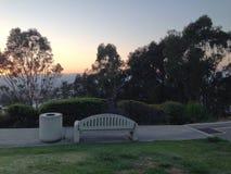 Um banco no monte no por do sol Fotografia de Stock Royalty Free