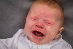 Um bebê de grito imagem de stock
