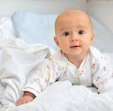 Um bebê de sorriso bonito fotografia de stock