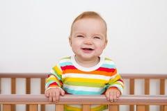 Um bebê está sorrindo Imagens de Stock Royalty Free