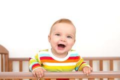 Um bebê está sorrindo Imagem de Stock Royalty Free