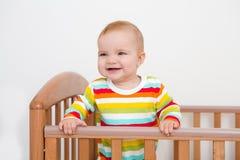 Um bebê está sorrindo Fotografia de Stock Royalty Free