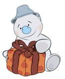 Um boneco de neve do Natal e uns desenhos animados da caixa Fotografia de Stock Royalty Free