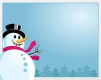 Um boneco de neve em um fundo azul Fotos de Stock