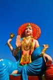 Um Buddha bonito e o céu azul foto de stock royalty free
