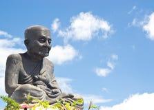 Um buddhism da escultura da monge Foto de Stock Royalty Free