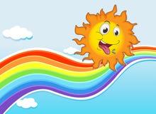 Um céu com um arco-íris e um sol feliz Fotografia de Stock