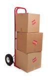 Um caminhão de mão vermelho no branco com caixas Fotografia de Stock Royalty Free