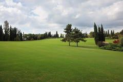 Um campo em um parque-jardim Sigurta Foto de Stock