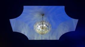 Um candelabro no teto com luz azul Imagem de Stock Royalty Free