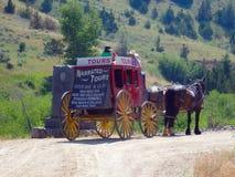 Um carrinho puxado por cavalos em idaho imagem de stock