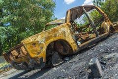 Um carro para fora queimado abandonado, roubado Imagem de Stock Royalty Free