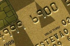 Um cartão de crédito do ouro Imagem de Stock Royalty Free