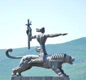 Um cavaleiro em um tigre Imagens de Stock Royalty Free