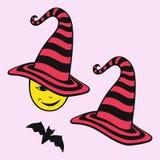 Um chapéu e um bastão Halloween Imagens de Stock Royalty Free