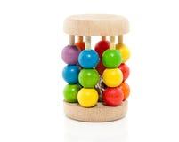 Um chocalho de madeira colorido Fotos de Stock