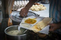 Um cliente com manteiga Masala Dosa imagens de stock