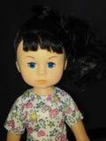 Um close up da boneca da menina Imagem de Stock