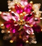 Um close up de um anel com muitas pedras imagens de stock royalty free