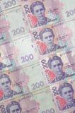 Um close-up de um teste padrão de muitas cédulas ucranianas da moeda com um valor nominal do hryvnia 200 Imagem de fundo no negóc Fotografia de Stock Royalty Free