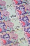 Um close-up de um teste padrão de muitas cédulas ucranianas da moeda com um valor nominal do hryvnia 200 Imagem de fundo no negóc Fotos de Stock