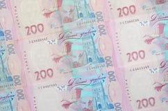 Um close-up de um teste padrão de muitas cédulas ucranianas da moeda com um valor nominal do hryvnia 200 Imagem de fundo no negóc Fotografia de Stock