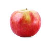 Um close-up inteiro da maçã Uma maçã crocante, isolada em um fundo branco A multi-colored healthful apple Verão doce foto de stock royalty free