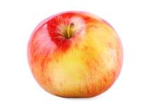 Um close-up inteiro da maçã Uma maçã saboroso e crocante, isolada em um fundo branco A multi-colored healthful apple foto de stock royalty free