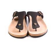 Um close-up marrom das sandálias dos pares. Imagem de Stock Royalty Free
