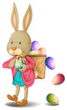 Um coelho com lotes dos ovos da páscoa Foto de Stock Royalty Free