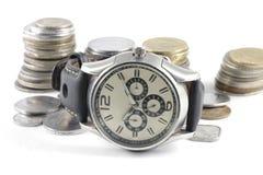 Um conceito do tempo e do dinheiro fotos de stock royalty free