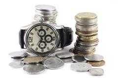 Um conceito do tempo e do dinheiro foto de stock