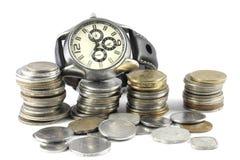 Um conceito do tempo e do dinheiro imagens de stock royalty free