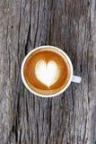 Um copo do café da arte do latte Fotografia de Stock