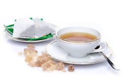 Um copo do chá com açúcar e saquinhos de chá Foto de Stock Royalty Free