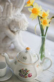 Um copo do chá, flores Imagem de Stock