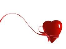 Um coração com uma fita   Imagens de Stock