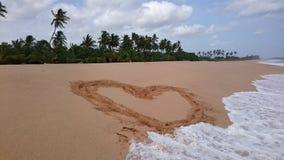 Um coração na areia Foto de Stock