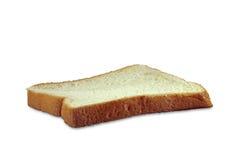 Um cortou o pão isolado no fundo branco Imagem de Stock Royalty Free