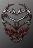 Um crânio estrangeiro tribal do metal Imagem de Stock Royalty Free