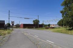 Um cruzamento de estrada de ferro sueco Imagens de Stock