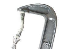 Um dólar Bill na braçadeira da corrente alternada Imagem de Stock Royalty Free