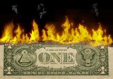 Um dólar a queimar-se Foto de Stock
