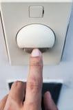 Um dedo está girando sobre um interruptor da luz fotografia de stock royalty free
