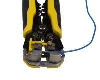 Um descascador de fios automático e um fio de cobre descascado Fotografia de Stock Royalty Free