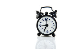 Um despertador preto pequeno Fotos de Stock Royalty Free