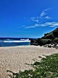 Um dia na praia é nunca tempo perdida imagens de stock