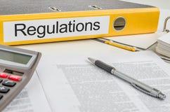 Um dobrador com os regulamentos da etiqueta Fotos de Stock Royalty Free